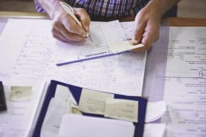 Man doing paperwork on desk | How to determine whether the word marks are similar