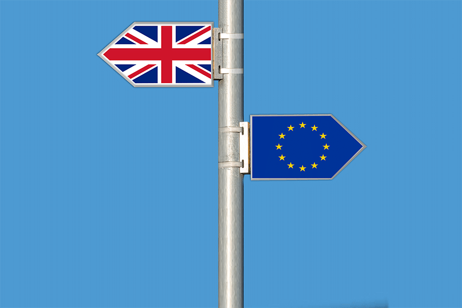 A pole with Union Jack flag and european flag on