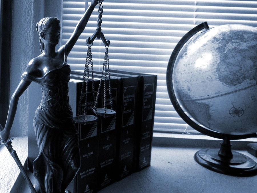 Lady justice and a world globe